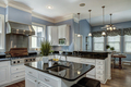 Large American style kitchen and dining room interior with granite countertops - PhotoDune Item for Sale