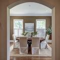 Elegant dining room through curved arch doorway - PhotoDune Item for Sale