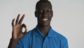 African American guy showing ok gesture on camera looking happy isolated on white background - PhotoDune Item for Sale