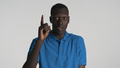 Amazed African American guy keeping index finger up showing idea on camera over white background - PhotoDune Item for Sale