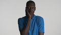 Handsome nice African American guy looking cute on camera over white background - PhotoDune Item for Sale