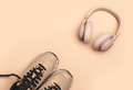 Girls hipster summer nude pink stuff for a walk: sneakers and wireless headphones - PhotoDune Item for Sale