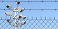 CCTV secutity cameras system and barbed wire fence. Privacy, security and protection concept. - PhotoDune Item for Sale