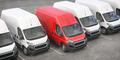 Red delivery van in a row of white vans. Best express delivery and shipemt service concept. - PhotoDune Item for Sale