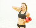 Beautiful woman with a mat after exercise - PhotoDune Item for Sale
