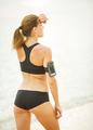 Beautiful woman running on the beach - PhotoDune Item for Sale