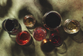 Red, rose and white wine in glasses on rusty green background, top view. Wine bar, shop, winery - PhotoDune Item for Sale