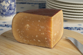 Piece of old mature sheep milk cheese on a cutting board - PhotoDune Item for Sale