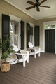 Charleston style porch with chairs and entry door on southern home - PhotoDune Item for Sale