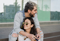 Young couple of lovers having fun outdoors at the city during vacation time - Focus on girl face - PhotoDune Item for Sale