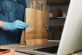 Courier preparing parcel package for delivery wearing protective gloves inside warehouse office - PhotoDune Item for Sale