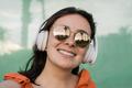 Happy latin girl having fun listening music with headphones doing selfie with mobile phone - PhotoDune Item for Sale