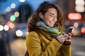 Woman on street using phone at evening - PhotoDune Item for Sale