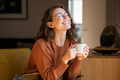 Cheerful woman enjoying coffee cup in a winter afternoon - PhotoDune Item for Sale