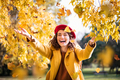Young playful woman playing with leaves in autumn - PhotoDune Item for Sale