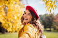 Smiling happy woman looking behind in an autumn day - PhotoDune Item for Sale