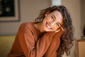 Young woman laughing while relaxing at home - PhotoDune Item for Sale