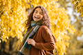 Happy girl laughing in autumn park - PhotoDune Item for Sale