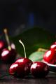 Red sweet cherries on brown table, selective focus - PhotoDune Item for Sale