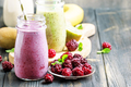 Multicolored berry and fruit smoothies, assorted in glass bottles, selective focus - PhotoDune Item for Sale