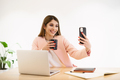 Smiling woman using the smartphone indoors - PhotoDune Item for Sale