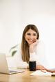 Smiling caucasian woman working on laptop - PhotoDune Item for Sale