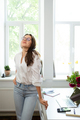 Businesswoman sitting at home and managing her business via home office - PhotoDune Item for Sale