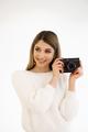Smiling woman holding camera on white background - PhotoDune Item for Sale