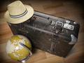 Tourism and travel concept. Globe and vintage suitcase with summer hat. - PhotoDune Item for Sale
