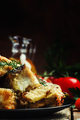 Fried fish, pieces of mullet with dill on a plate. Vintage wooden background, selective focus - PhotoDune Item for Sale