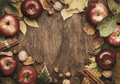 Autumn food background. Ripe apples with nuts, fallen leaves and cinnamon - PhotoDune Item for Sale