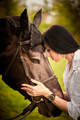 A young woman hugs a horse - PhotoDune Item for Sale