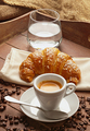 Espresso with croissant and glass of water - PhotoDune Item for Sale