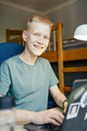 Young Man Smiling and Looking at Camera - PhotoDune Item for Sale