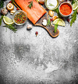 Raw fish. Fresh salmon fillet with herbs and spices. On rustic background. - PhotoDune Item for Sale