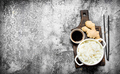 Asian food. Boiled rice with soy sauce on the old Board. On rustic background. - PhotoDune Item for Sale