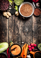 Organic Food. A variety of beans with fresh vegetables and spices. On the old wooden table. - PhotoDune Item for Sale