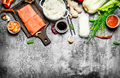 Asian food. Boiled rice with a piece of salmon and a variety of ingredients. On rustic background . - PhotoDune Item for Sale