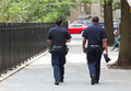 Two police officers from the back in the center of Manhattan. - PhotoDune Item for Sale