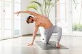 Sporty athletic man doing yoga mobility exercises - PhotoDune Item for Sale
