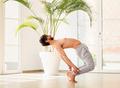 Athletic man doing a calisthenics backbend balance pose - PhotoDune Item for Sale