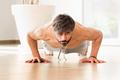 Determined athletic man exercising on push-ups - PhotoDune Item for Sale