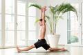 Man performing a Hanumanasna or Monkey yoga pose - PhotoDune Item for Sale