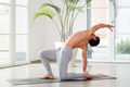 Man doing a backbend and twist yoga pose to increase mobility - PhotoDune Item for Sale