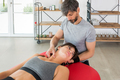 Osteopath performing a Sternocleidomastoid myofascial massage - PhotoDune Item for Sale