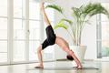 Man doing a Chakrasana yoga pose or backbend stretch - PhotoDune Item for Sale