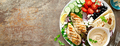 Chicken breast grilled with fresh vegetables flatbread and hummus, top view, banner - PhotoDune Item for Sale
