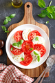 Caprese Salad with fresh tomatoes, basil and mozzarella cheese, top view - PhotoDune Item for Sale