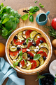 Vegetable tart with zucchini, aubergine, tomato, olives and feta cheese, top view - PhotoDune Item for Sale