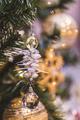 Beautiful shiny New Year decorations on Christmas tree - PhotoDune Item for Sale